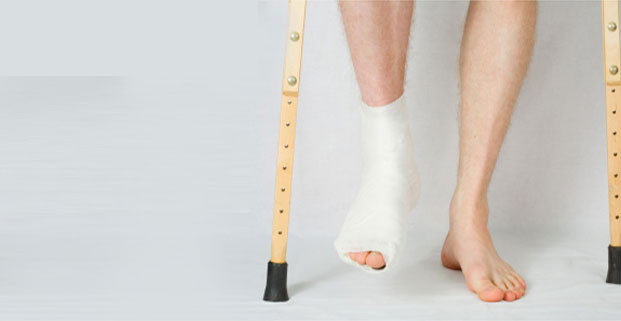 Man with Ankle and Foot in Plaster and Crutches