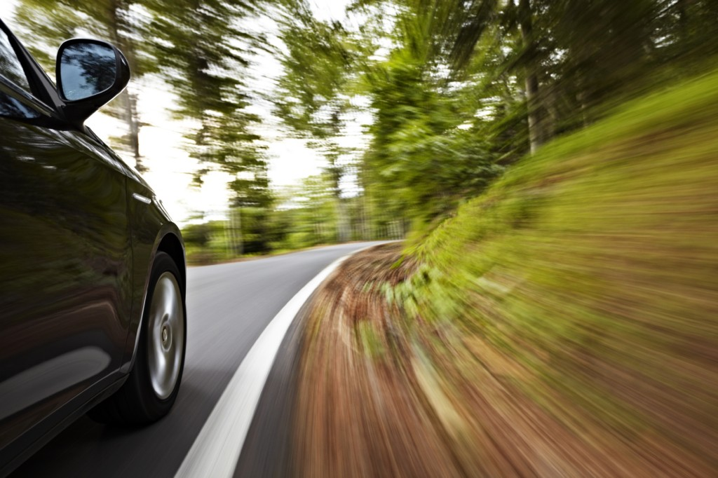 Driving on a Curve - iStock_000016981541_Medium