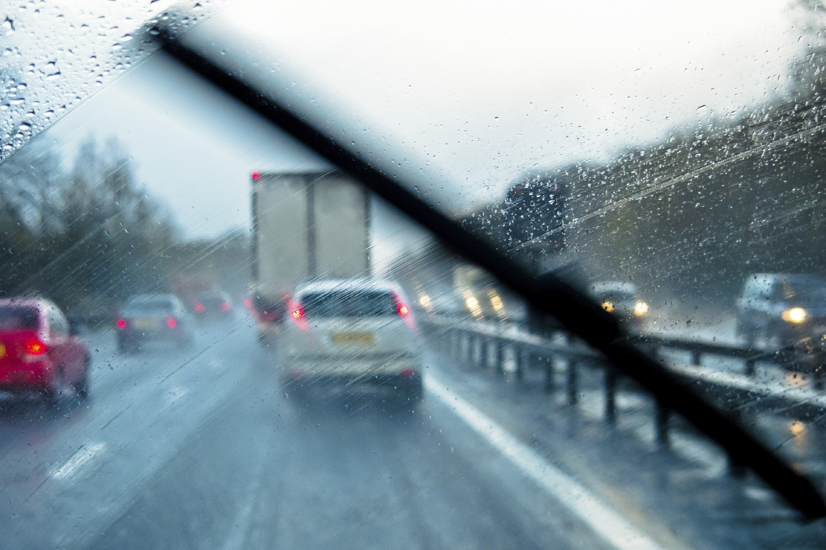 Rain through the window of a car on a motorway