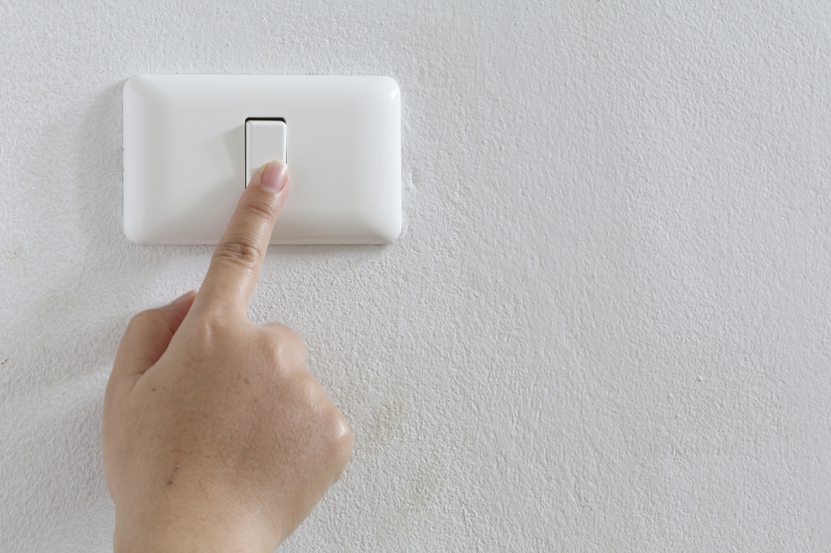 closeup finger press turn on/off electric-switch